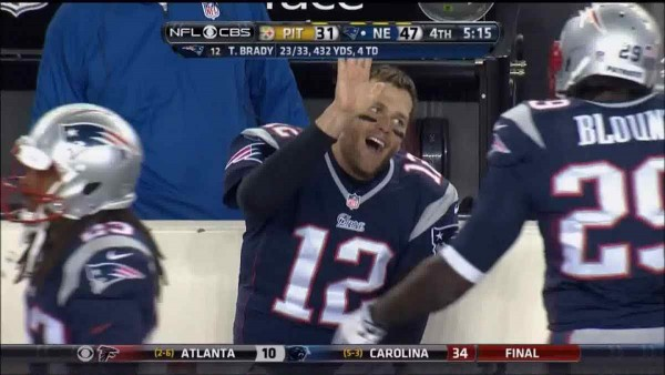 Tom Brady looks for a high five. (Photo From: The Big Lead)