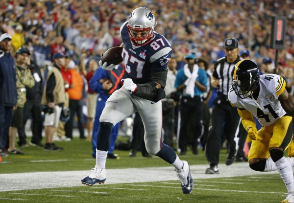 Gronk runs in for the score. (Photo By: AP/Winslow Townson)