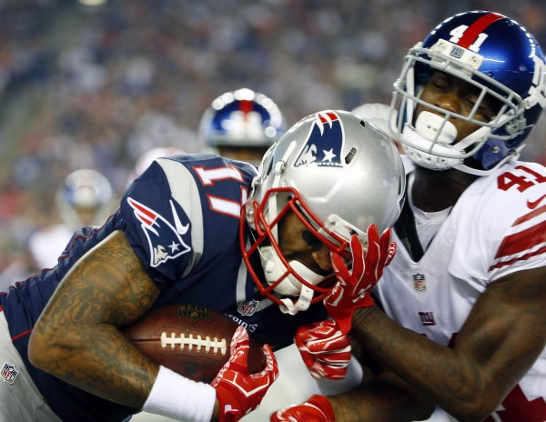 Dominique Rodgers-Cromartie tackles WR Aaron Dobson. (AP Photo/Winslow Townson)