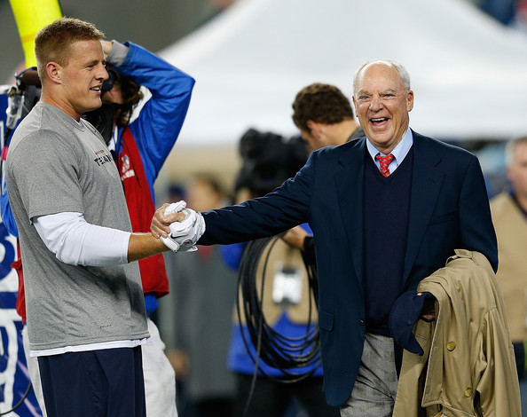 JJ Watt and Bob McNair shake hands before a game against the Patriots in 2012. (Photo By:  Jim Rogash/Getty Images North America)