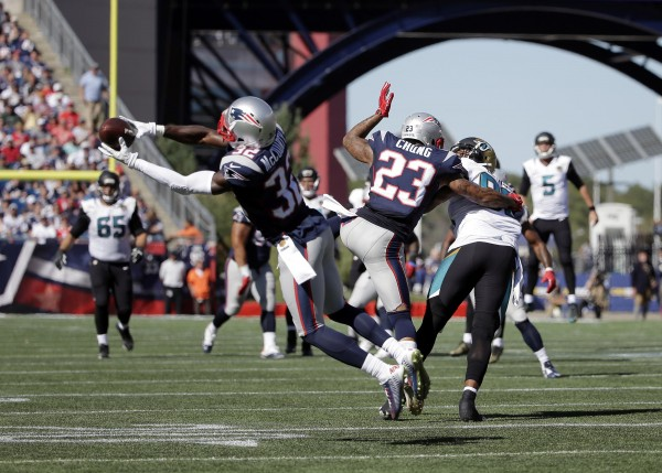 Devin McCourty with the INT. (Photo by: AP Photo/Steven Senne)