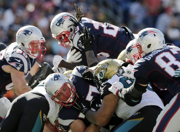 LeGarrette Blount over the top for the touchdown. He had three on the day. (Photo By: AP Photo/Charles Krupa)