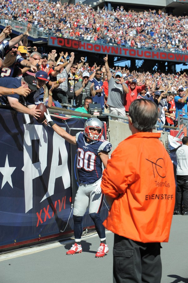 Amendola gives the ball to a fan. (Photo By: KEITH NORDSTROM)