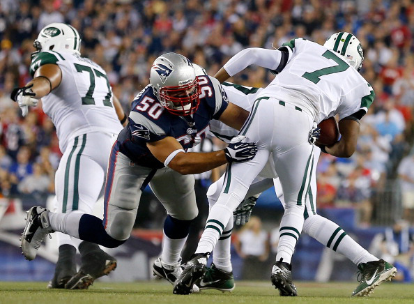 Rob Ninkovich made a big play against the Jets in 2013. (Photo by Jim Rogash/Getty Images)
