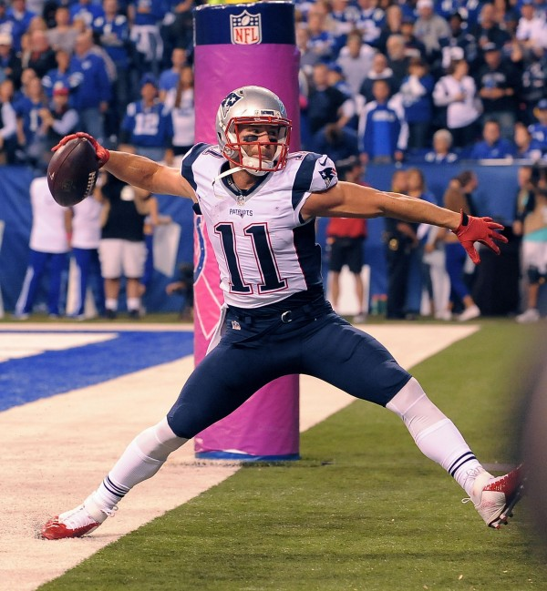 Julian Edelman spikes a football straight into the Colts logo after a touchdown catch. The Pats won that game and are winning at power rankings. (Photo By: Keith Nordstrom)