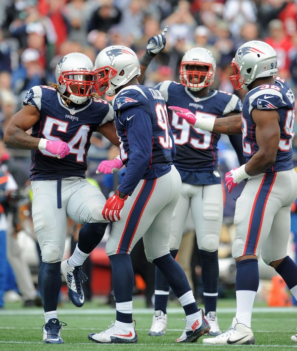 Dont'a Hightower, Jamie Collins celebrate with the team after a play against the Jets. (Photo By: Keith Nordstrom)