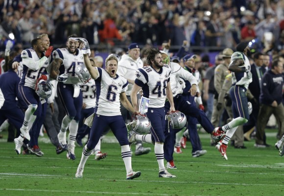 The Patriots celebrate their fourth Super Bowl win after defeating the Seahawks on February 1, 2015. (Photo By: AP Photo/Brynn Anderson)