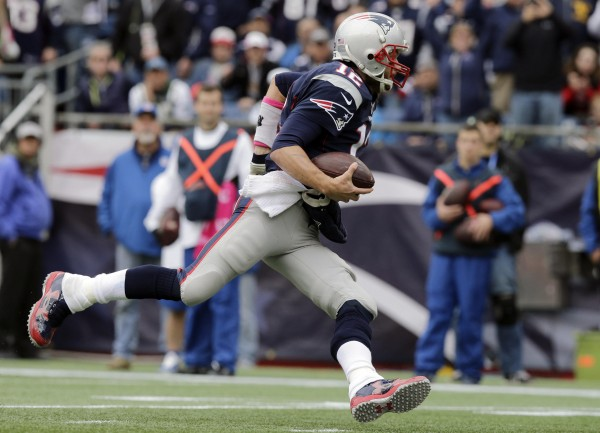 For the first time in his career, Tom Brady led the team in rushing with 15 yards. He also added a rushing touchdown. (Photo By: AP/Charles Krupa)