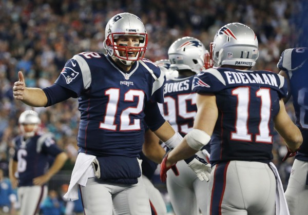 Tom Brady found Julian Edelman twice for touchdowns in their route over the Dolphins. (Photo By: AP Photo/Michael Dwyer)