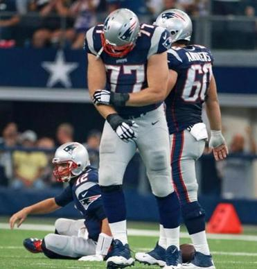 Nate Solder during the Cowboys game after he injured his right arm. (Photo By: JIM DAVIS/GLOBE STAFF)
