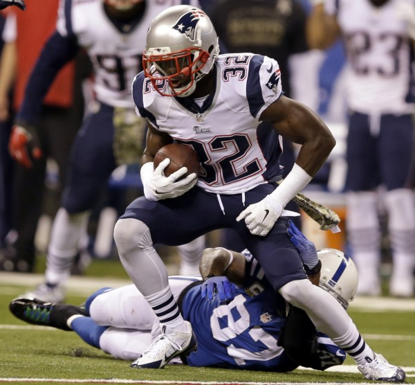 Patriots FS Devin McCourty intercepted Andrew Luck during a game last year. (Photo By: AP Photo/Darron Cummings)