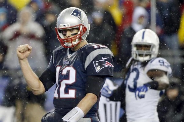 Tom Brady celebrates during the AFC Title Game back in January. (Photo By: Elise Amendola/Associated Press)