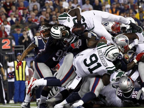 RB Chris Ivory tries to go up and over the Pats defense from last year's first meeting. (Photo By: Mark L. Baer – USA Today Sports Images)