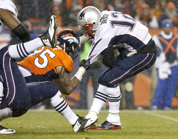 Tom Brady was pressured at the perfect time for Denver.  (AP Photo/Joe Mahoney)