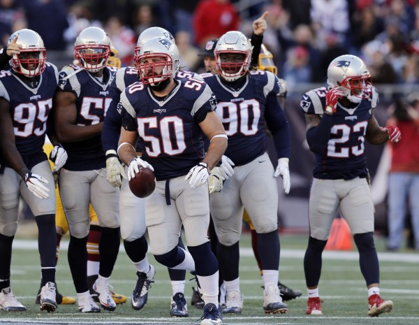 Rob Ninkovich recovers a fumble caused by Alan Branch. The defense had a great day. (Photo By: AP Photo/Charles Krupa)