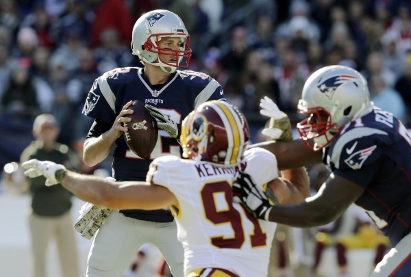 Tom Brady afforded protection while looking for an open WR. (Photo By: AP Photo/Charles Krupa)