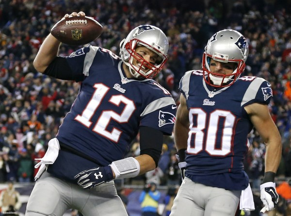 Brady, Amendola, and the Patriots favored over the Broncos, according to Vegas. (Photo By: Elise Amendola/AP