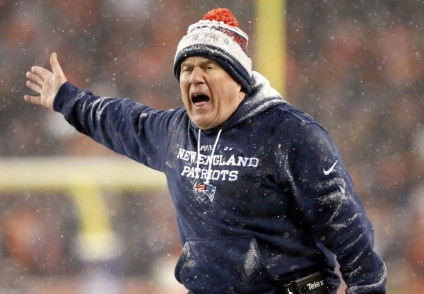 New England Patriots head coach Bill Belichick not happy in the second half of last night's game.    (AP Photo/Joe Mahoney)