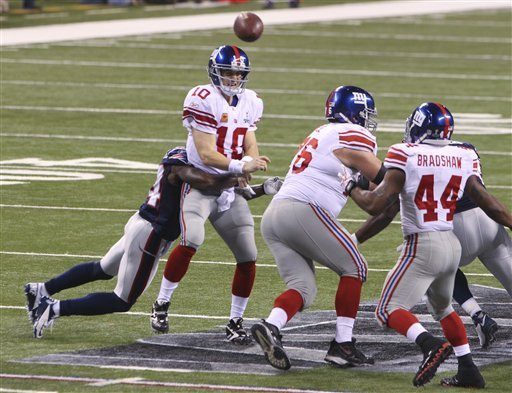 Pressuring Eli needs to be done by the Pats defense. (Photo From Masslive.com)