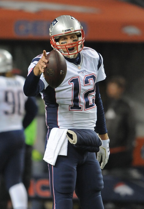 "Tom Brady talks to WEEI guys after a ""tough loss."" (Photo By: Keith Nordstrom)"
