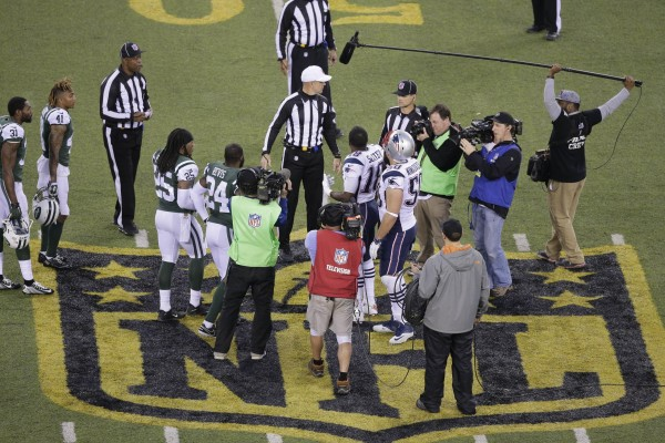 Overtime coin flip and Matthew Slater's confusion with the refs. (Photo From AP Photo/Peter Morgan)