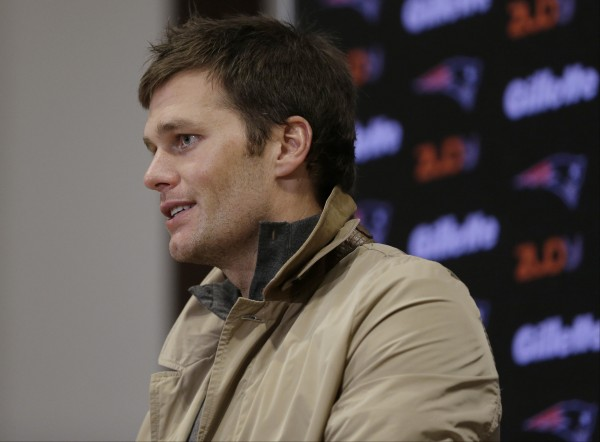 Tom Brady and Bill Belichick address the media. (AP Photo/Charles Krupa)