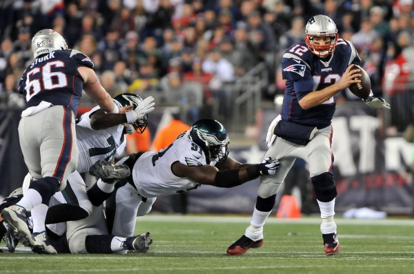 Tom Brady is carrying this team and defenders on his back. (Photo By: Keith Nordstrom)