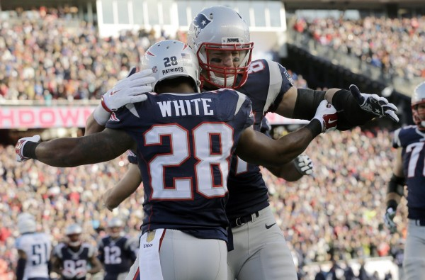 Rob Gronkowski celebrates with James White after White's catch and run touchdown.  (Photo by: AP Photo/Steven Senne)