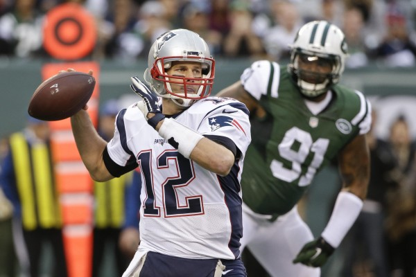 Tom Brady was under pressure for most of the game  (Photo By: AP Photo/Seth Wenig)