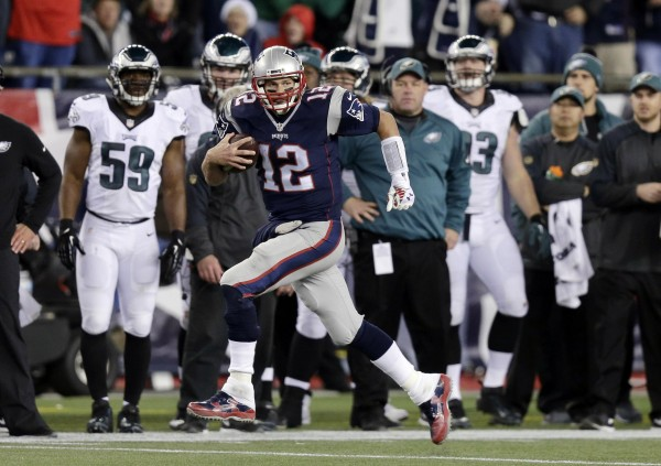 Tom Brady's catch and run. (AP Photo/Charles Krupa)