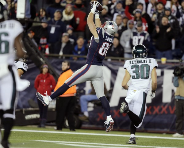 Scott Chandler (88) catches a touchdown pass. (Photo By: AP Photo/Charles Krupa)