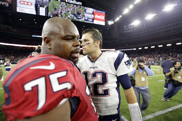 Former Patriots great NT  Vince Wilfork greets QB Tom Brady after the game. (Photo by: AP Photo/David J. Phillip)