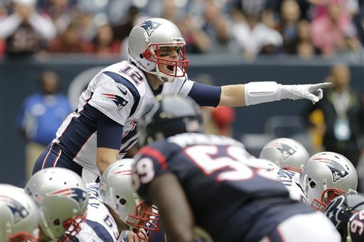 Guesses each game's week 14 winners.  (Photo By: Patric Schneider/Associated Press)
