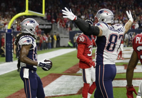 Wide Receiver Keshawn Martin celebrates his touchdown with TE Rob Gronkowski. (Photo By: AP Photo/David J. Phillip)