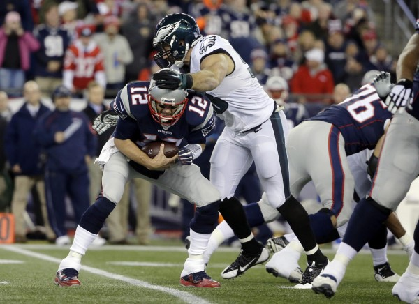 Tom Brady was under pressure throughout the game. (Photo By AP Photo/Steven Senne)