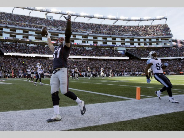 Gronk celebrates his 11th touchdown catch of the season by pointing to the sky to remember his friend who died earlier in the week. (Photo By: AP Photo/Charles Krupa)