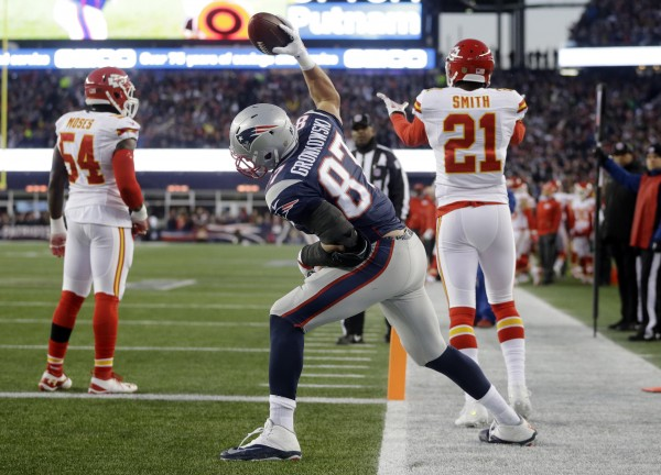 Gronk caught 7 passes for 83 yards and two touchdowns. which were celebrated by Spikes.  (Photo By: AP Photo/Steven Senne)