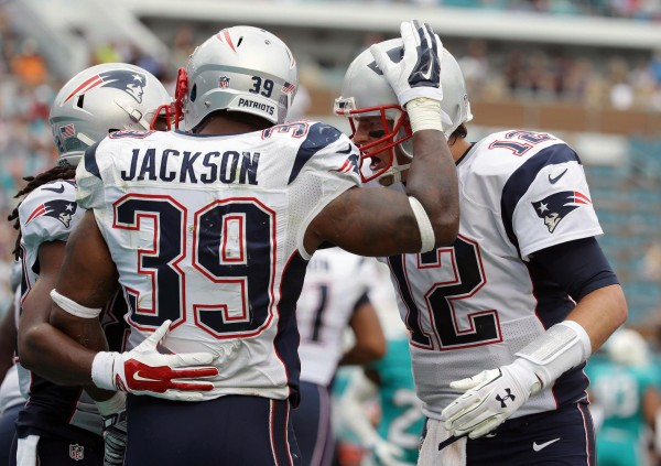 Jackson and the Gang celebrate his first touchdown that tied up the game. (Photo By: AP Photo/Lynne Sladky)