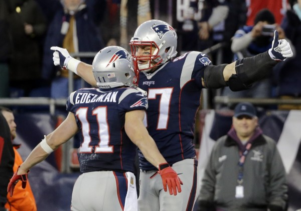 Edelman and Gronk celebrate in chest bumping style after a Gronk spike.  (Photo By: AP Photo/Elise Amendola)