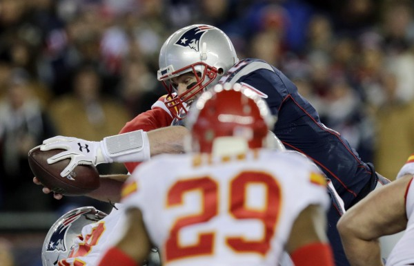 Tom Brady QB sneaks into the end zone.  (Photo by: AP Photo/Charles Krupa)
