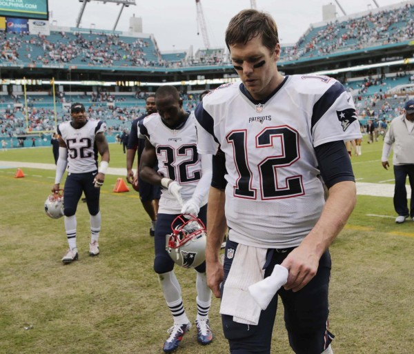 Tom Brady walks off the field after a long day on them. (Photo by: AP Photo/Lynne Sladky)