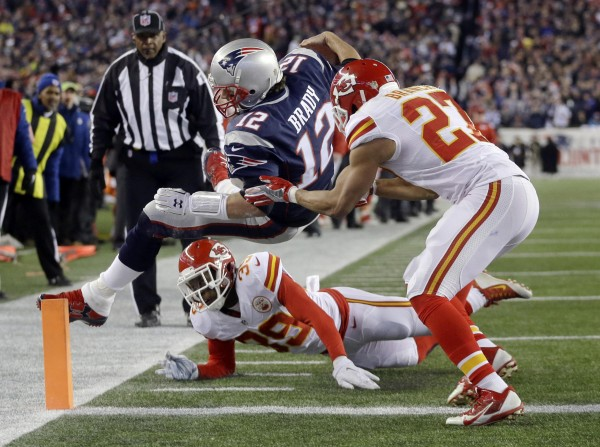 Tom Brady dives for the end zone. (Photo by: AP Photo/Steven Senne)