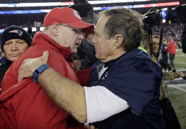 Andy Reid and Belichick meet after the game. (Photo by: AP Photo/Charles Krupa)