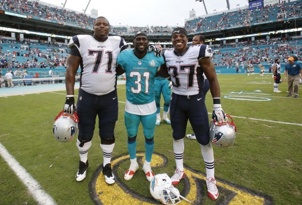 Pats OL Cameron Fleming, SS Jordan Richards, and Dolphins Michael Thomas (Photo By: AP Photo/Wilfredo Lee)