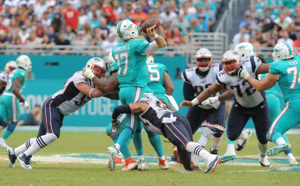 Sheard wraps up Tannehill. (Photo By: Keith Nordstrom)
