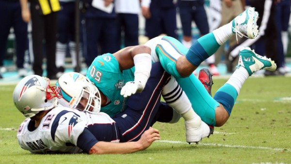 Dolphins defense was around Brady all day, but one hit drew a fine from the league. (Photo From Palm Beach Post.com)